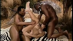 Kinky bitch is getting her mouth and cunt pounded by two black dudes