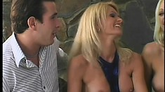 Two voluptuous blonde cougars get fucked hard side by side on the sofa