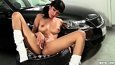 Now she sits on the seat and rubs, then toys her slippery slit